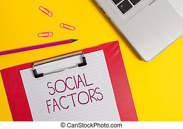 Text sign showing Social Factors. Business photo text Things that influences lifestyle Cultural Differences Slim metallic laptop clipboard paper sheet clips pencil colored background