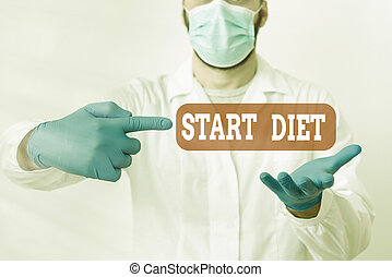 Text sign showing Start Diet. Conceptual photo the practice of eating food in a regulated and supervised fashion Laboratory Technician Featuring Empty Sticker Paper Accessories Smartphone.