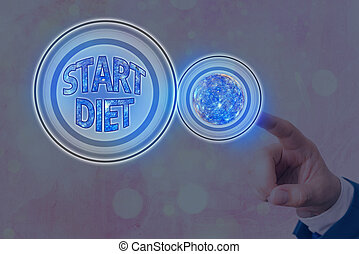 Text sign showing Start Diet. Conceptual photo the practice of eating food in a regulated and supervised fashion Futuristic icons solar system. Elements of this image furnished by NASA.