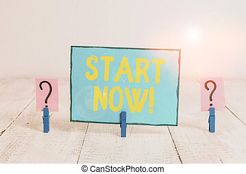 Text sign showing Start Now. Conceptual photo do not hesitate get working or doing stuff right away Scribbled and crumbling sheet with paper clips placed on the wooden table.