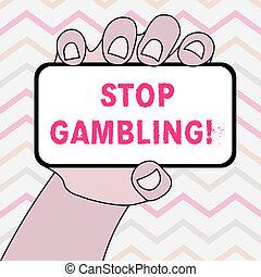 Text sign showing Stop Gambling. Conceptual photo stop the urge to gamble continuously despite harmful costs Closeup of Smartphone Device Held in Hand with Blank Screen and Text Space.