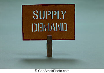 Text sign showing Supply Demand. Conceptual photo Relationship between the amounts available and wanted Clothespin holding orange paper important communicating message ideas.
