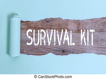 Text sign showing Survival Kit. Conceptual photo Emergency Equipment Collection of items to help someone.