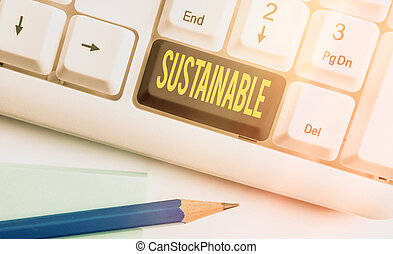 Text sign showing Sustainable. Business photo text the ability to be sustained, supported, upheld, or confirmed Different colored keyboard key with accessories arranged on empty copy space