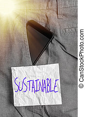 Text sign showing Sustainable. Business photo text the ability to be sustained, supported, upheld, or confirmed Smartphone device inside formal work trousers front pocket near note paper