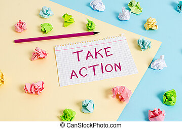 Text sign showing Take Action. Conceptual photo to do somethingoract in order to get a particular result Colored crumpled papers empty reminder blue yellow background clothespin.