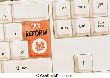 Text sign showing Tax Reform. Conceptual photo government policy about the collection of taxes with business owners Different colored keyboard key with accessories arranged on empty copy space.