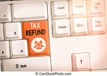 Text sign showing Tax Refund. Conceptual photo excess payment of paid taxes returned to business owners Different colored keyboard key with accessories arranged on empty copy space.