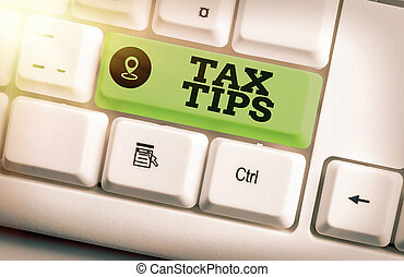 Text sign showing Tax Tips. Conceptual photo compulsory contribution to state revenue levied by government Different colored keyboard key with accessories arranged on empty copy space.