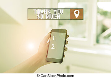 Text sign showing Thank You So Much. Conceptual photo Expression of Gratitude Greetings of Appreciation woman using smartphone office supplies technological devices inside home.