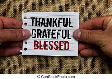 Text sign showing Thankful Grateful Blessed. Conceptual photo Appreciation gratitude good mood attitude Man holding piece notebook paper jute background Communicating ideas.