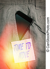 Text sign showing Time To Move. Conceptual photo change in the same way or to reflect on what is current Smartphone device inside formal work trousers front pocket near note paper.