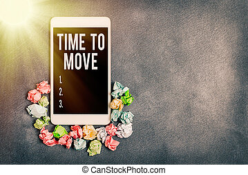 Text sign showing Time To Move. Conceptual photo change in the same way or to reflect on what is current Paper accesories with digital smartphone arranged on different background.