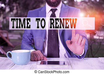 Text sign showing Time To Renew. Conceptual photo Continue the insurance acquired Life and property protection Businessman with pointing finger in front of him.
