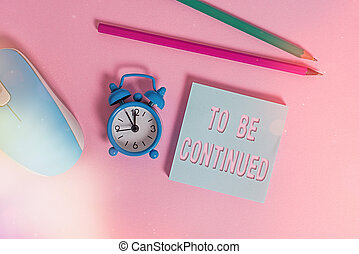 Text sign showing To Be Continued. Conceptual photo indicate that the story continues in the next episode Alarm clock wakeup blank notepad mouse markers colored background.
