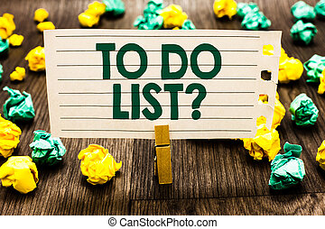 Text sign showing To Do List question. Conceptual photo Series of task to be done organized in priority order Clothespin holding notebook paper crumpled papers several tries mistakes.