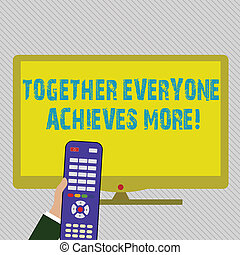 Text sign showing Together Everyone Achieves More. Conceptual photo Members create synergy with strong sense mutual commitment Hand Holding Computer Remote Control infront of Blank Wide Color PC Screen.