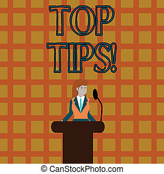Text sign showing Top Tips. Conceptual photo small but particularly useful piece of practical advice Businesswoman Standing Behind Podium Rostrum Speaking on Wireless Microphone.