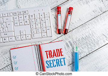 Text sign showing Trade Secret. Conceptual photo Confidential information about a product Intellectual property Extracted blood sample vial with medical accessories ready for examination.