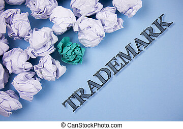 Text sign showing Trademark. Conceptual photo Legally registered Copyright Intellectual Property Protection written on the Plain Blue background Paper Balls next to it.