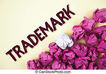 Text sign showing Trademark. Conceptual photo Legally registered Copyright Intellectual Property Protection written on Plain background Crumpled Paper Balls next to it.