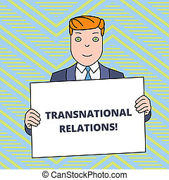 Text sign showing Transnational Relations. Conceptual photo International Global Politics Relationship Diplomacy Smiling Man Holding Formal Suit Big Blank Poster Board in Front of Himself.