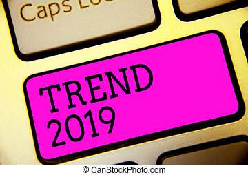 Text sign showing Trend 2019. Conceptual photo things that is famous for short period of time in current year Keyboard purple key Intention create computer computing reflection document.