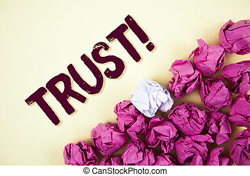Text sign showing Trust Motivational Call. Conceptual photo Belief in the Reliability Truth Ability Confidence written on Plain background Crumpled Paper Balls next to it.