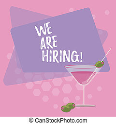 Text sign showing We Are Hiring. Conceptual photo pay someone to do a particular job for company in future Filled Cocktail Wine Glass with Olive on the Rim Blank Color Text Space.