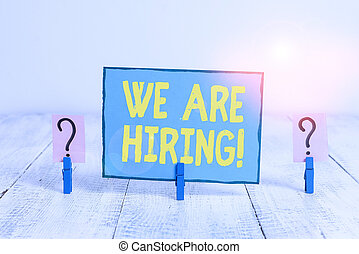 Text sign showing We Are Hiring. Conceptual photo recently you employ someone or pay someone to do particular job Scribbled and crumbling sheet with paper clips placed on the wooden table.