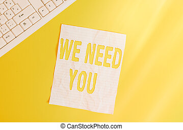 Text sign showing We Need You. Conceptual photo asking someone to work together for certain job or target Copy space on notebook above yellow background with pc keyboard on the table.
