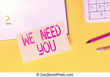 Text sign showing We Need You. Conceptual photo asking someone to work together for certain job or target Empty orange paper with copy space on the yellow table.