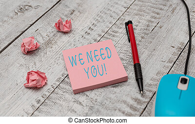 Text sign showing We Need You. Conceptual photo asking someone to work together for certain job or target Writing equipment and computer mouse with paper sheets on the wooden desk.