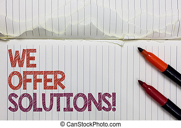 Text sign showing We Offer Solutions. Conceptual photo Offering help assistance Experts advice strategies ideas White torn page written some letters beside laid two red marker.