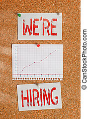 Text sign showing We Re Hiring. Conceptual photo recently employ someone or pay him to do particular job Corkboard color size paper pin thumbtack tack sheet billboard notice board.