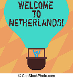 Text sign showing Welcome To Netherlands. Conceptual photo Warm greeting to the visitors of Netherlands Hu analysis Dummy Arms Raising inside Gondola Riding Blank Color Air Balloon.