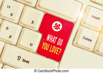 Text sign showing What Do You Love Question. Conceptual photo Enjoyable things passion for something inspiration White pc keyboard with empty note paper above white background key copy space.