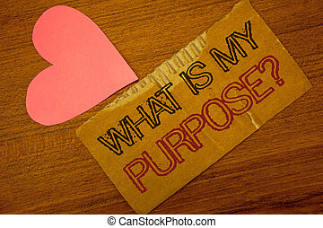 Text sign showing What Is My Purpose Question. Conceptual photo Direction Importance Discernment Reflection Peru color torn page with engraved black red text woody desk pink heart.