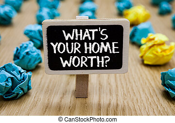 Text sign showing What s is Your Home Worth question. Conceptual photo Value of a house Property Cost Price Rate Paperclip hold written chalkboard behind paper lumps on woody deck