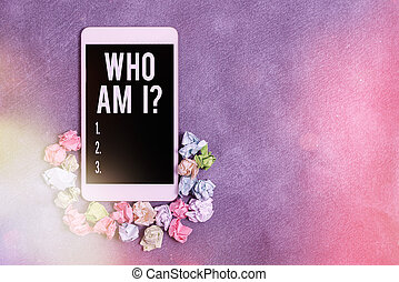 Text sign showing Who Am I Question. Conceptual photo asking about selfidentity or an individualal purpose in life Paper accesories with digital smartphone arranged on different background.