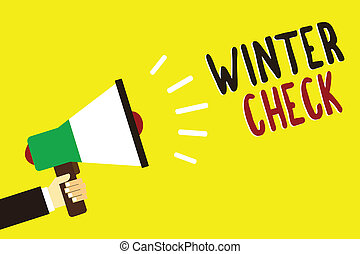 Text sign showing Winter Check. Conceptual photo Coldest Season Maintenance Preparedness Snow Shovel Hiemal Man holding megaphone loudspeaker yellow background message speaking loud.
