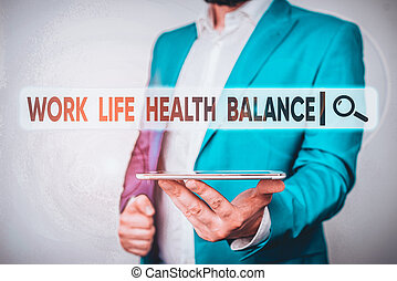 Text sign showing Work Life Health Balance. Conceptual photo Stability and Harmony to prevent burnt out Man in the blue suite and white shirt holds mobile phone in the hand.