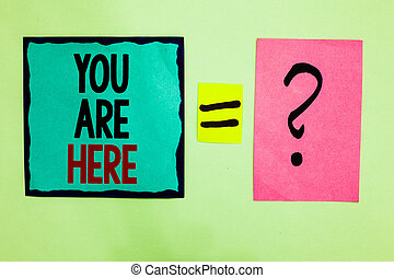 Text sign showing You Are Here. Conceptual photo This is your location reference point global positioning system Black lined written note middle queal pink page black question mark.