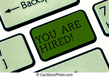 Text sign showing You Are Hired. Conceptual photo Recruitment being selected for a job the right candidate Keyboard key Intention to create computer message pressing keypad idea.