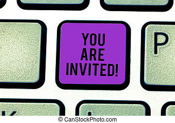 Text sign showing You Are Invited. Conceptual photo Receiving and invitation for an event Join us to celebrate Keyboard key Intention to create computer message pressing keypad idea.