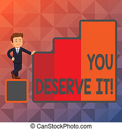 Text sign showing You Deserve It. Conceptual photo should have it because of their qualities or actions Happy Businessman Presenting Growth and Success in Rising Bar Graph Columns.