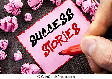 Text sign  Success Stories. Business concept for Successful Inspiration Achievement Education Growth written Pin Sticky Note Paper Folded Paper the wooden background Man Holding Marker Hand