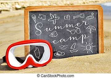 text summer camp in a chalkboard on the beach