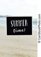 text summer time in a signboard on the beach