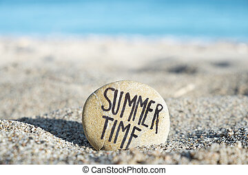 text summer time in a stone on the beach